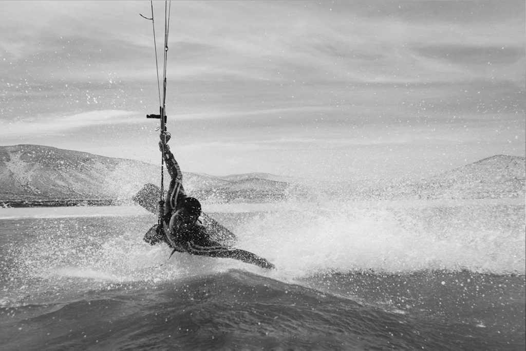 Fluid kiteboarding rider Gilion goveia darkslide black and white photo by ilja huner