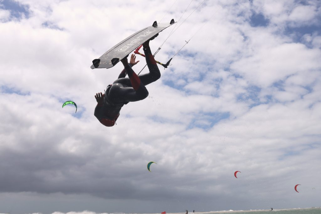 gilion fluid kiteboarding showing off his fins